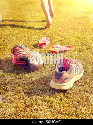 Summer is here - no need for socks and shoes - Stock Photo