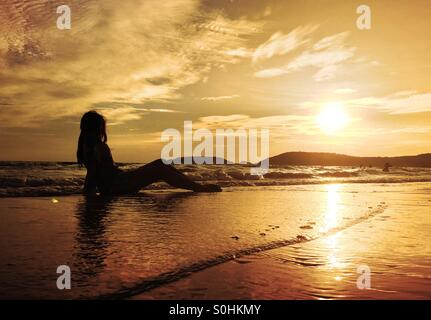 Lonely girl on the beach - Stock Photo