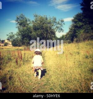 Little girl exploring - Stock Photo
