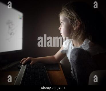 Child at the computer - Stock Photo