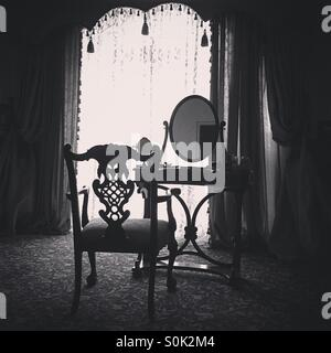 dressing table with mirror and chair in the room - Stock Photo
