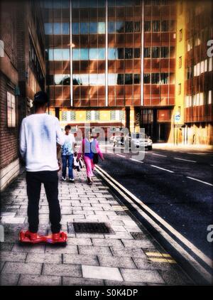 Man riding a dual wheel self balancing electric scooter, Harrow-on-the-hill, London Borough of Harrow, North West London, England, United Kingdom, Europe