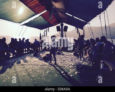 Children enjoying soap party on sailing boat - Stock Photo