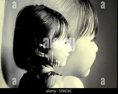 Double exposure photo of a little girl - Stock Photo