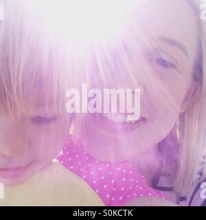 Mother and daughter sunshine selfie - Stock Photo