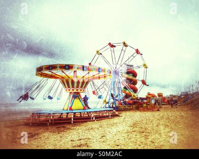 Seaside amusements at the end of the season. - Stock Photo