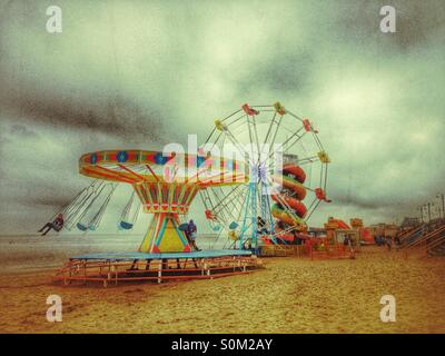 End of season at the seaside amusements. - Stock Photo