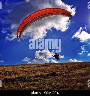 Paraglider launching - Stock Photo
