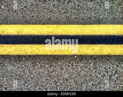 Double yellow lines on Highway - Stock Photo