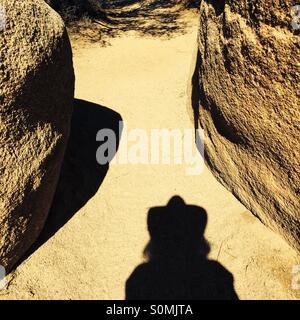 My shadow hiking in the Mohave Desert in San Bernardino County, California USA - Stock Photo