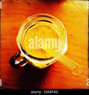 Juice smoothie in a jar mug with straw - Stock Photo