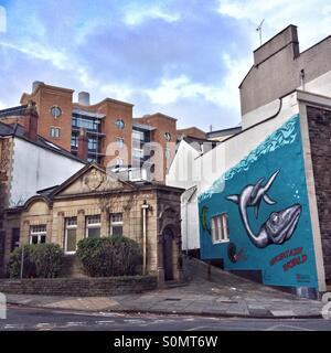 'Uncertain World', a mural by Alex Lucas alongside the Edwardian Cloakroom, an art gallery in Bristol, England - Stock Photo
