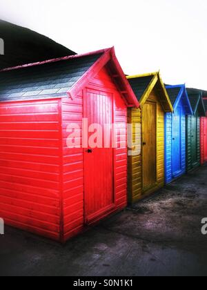 Colourfully painted beach huts at Whitby North Yorkshire England UK - Stock Photo