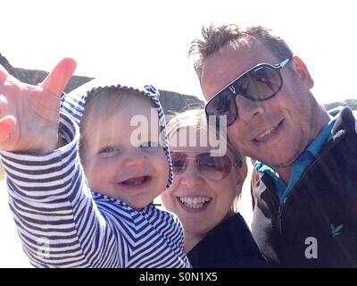 Family selfie on holiday - Stock Photo