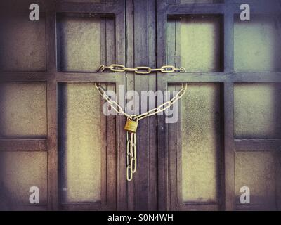 Gate locked with a chain - Stock Photo