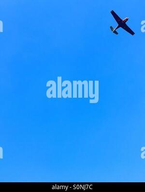 Minimalist plane on blue sky
