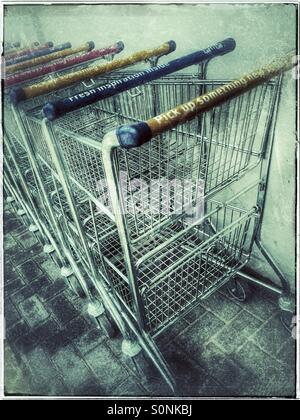 Supermarket trolleys outside store. - Stock Photo