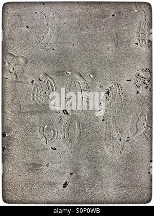 Footprints in wet sand. - Stock Photo