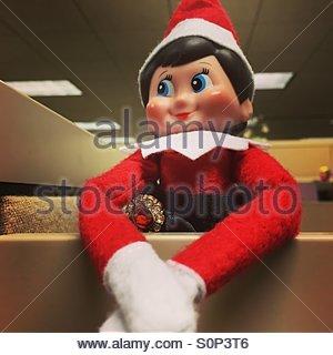 The elf on a shelf is always watching. - Stock Photo