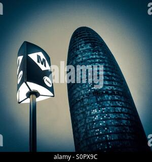 Barcelona underground sign and Agbar tower. Catalonia, Spain, Europe - Stock Photo
