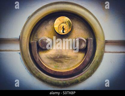 Door lock padlock smiling. Faces in objects - Stock Photo