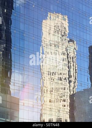 Skyscraper reflection on the glass the side of the Time Warner Center in New York City - Stock Photo