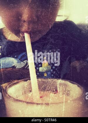 Drinking through a straw - Stock Photo