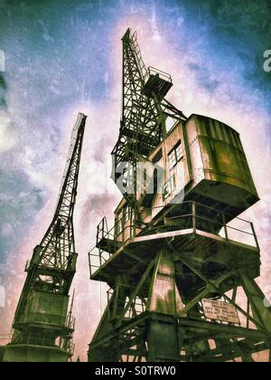 Two of the Large Cranes situated on the edge of The Floating Harbour, close to the City Centre of Bristol, England. - Stock Photo