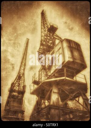 A Sepia Antique Effect Picture of Two Cranes that are situated on the edge of The Floating Harbour, close to the - Stock Photo