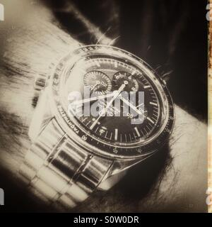 Omega speedmaster professional wristwatch . Black and white photo. - Stock Photo
