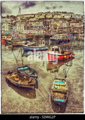 A Grunge Effect Picture of Boats in Mevagissey Harbour, Cornwall, England. A typical English Harbour Town view. - Stock Photo