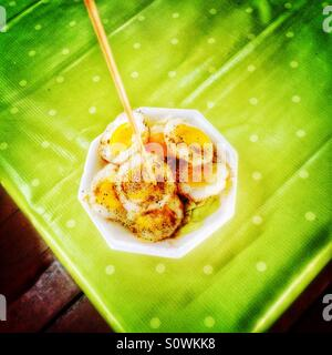 Fried quail eggs snack in Thailand - Stock Photo