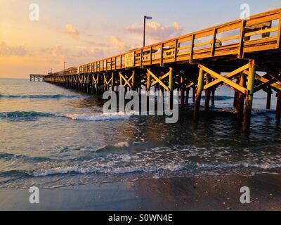 Sunrise at a pier in Myrtle Beach SOuth Carolina. - Stock Photo