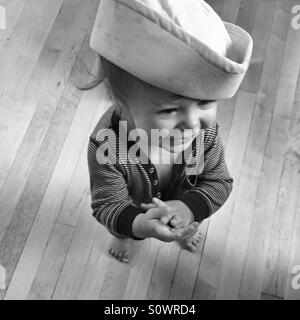 Happy baby wearing a sailor's hat, in black and white - Stock Photo
