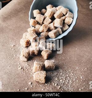 Brown sugar in a ceramic dish - Stock Photo