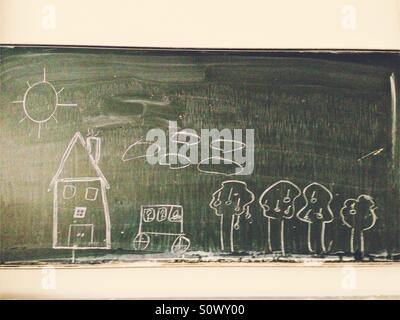 A house, a car, trees and clouds drawn with white chalk on a green chalkboard at school - Stock Photo
