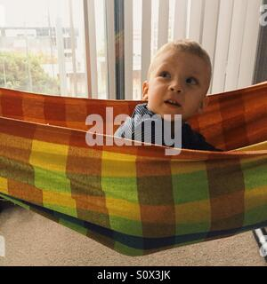 Little boy in hammock - Stock Photo