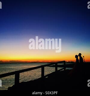 Couple kissing in the beautiful sunset - Stock Photo