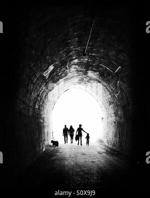 Walking is the last trend to be healthy, so people walk a lot to run away the light at the end of the tunnel. - Stock Photo