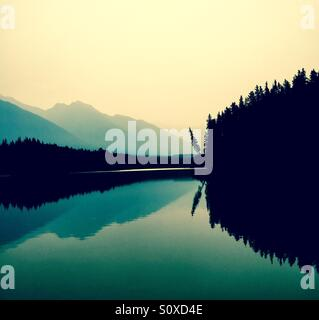 Reflections on a lake - Stock Photo