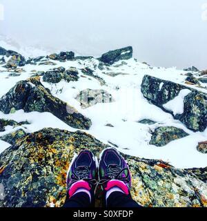 Hiking on a snowy mountain - Stock Photo