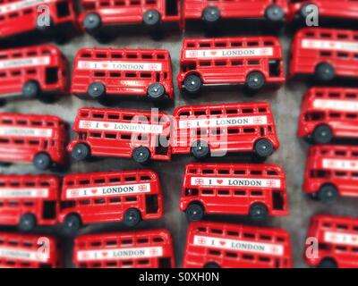 Red busses sold as souvenirs in Camden Town, London, UK - Stock Photo