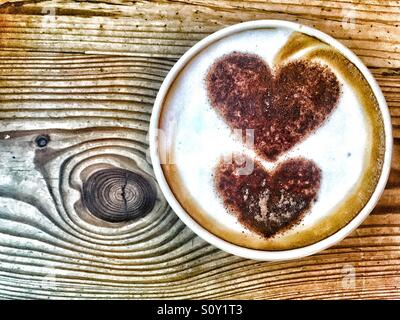 Late art hearts in cappuccino cup - Stock Photo