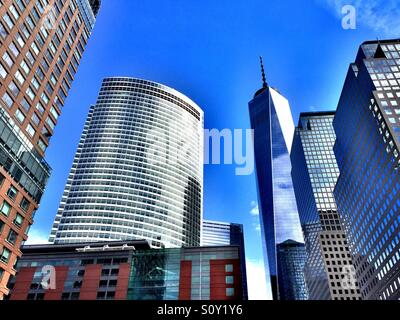 Freedom Tower and other skyscrapers at the 911 memorial site in downtown New York City - Stock Photo