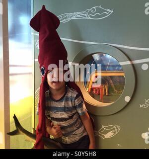 Portrait of a boy in sea animal costume - Stock Photo