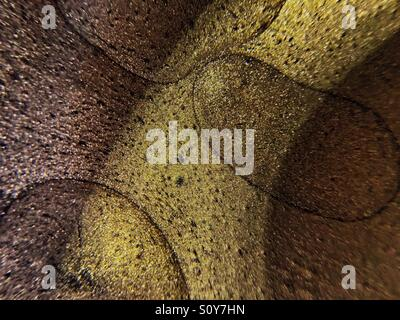 'Liquidity'     Pot of metallic paint, olloclip macro @ 14x magnification. - Stock Photo