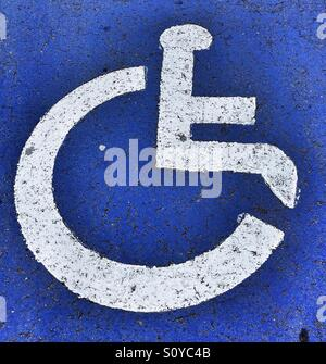 Handicapped sign on the road - Stock Photo