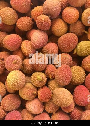 Stack of fresh lychees - Stock Photo
