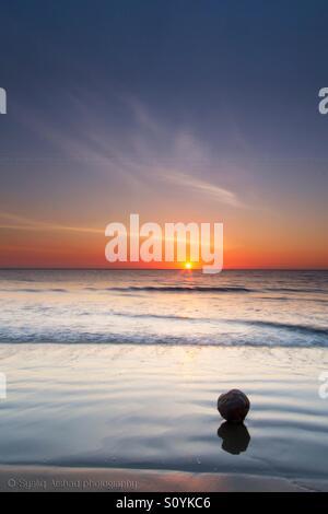 Sunset at Tanjung Aru Beach. Tanjung Aru is a sub-district of Kota Kinabalu in Sabah, of Malaysia. Its main feature - Stock Photo