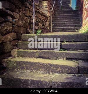 View looking up a steep flight of stone steps - Stock Photo